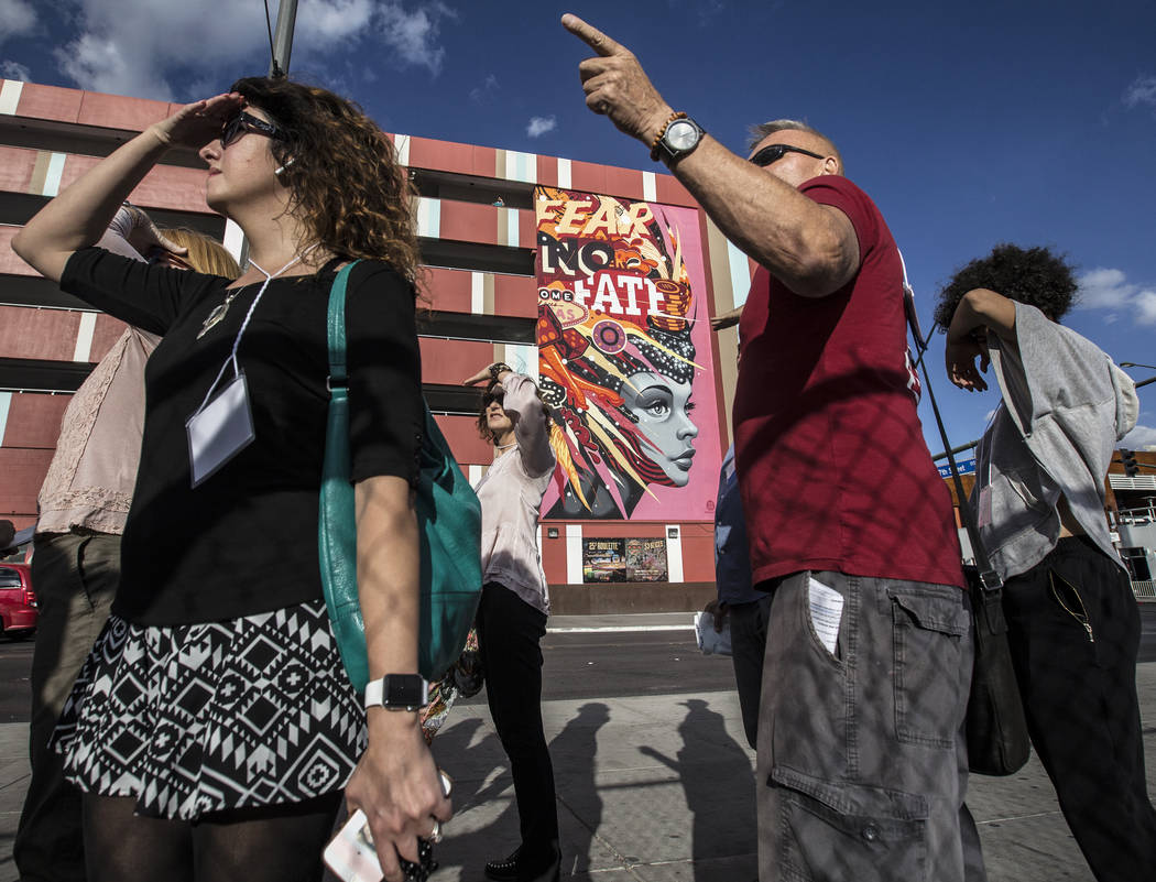 Cultural urbanist Richard Hooker, right, of Las Vegas Urban Adventures, leads a ten-block walking tour of downtown Las Vegas on Thursday, November 2, 2017. Benjamin Hager Las Vegas Review-Journal  ...
