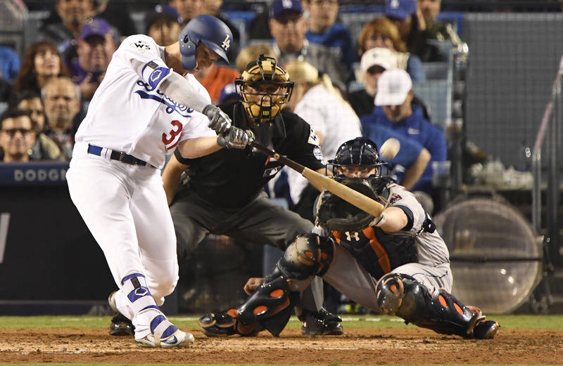 Oct 31, 2017; Los Angeles, CA, USA; Los Angeles Dodgers center fielder Joc Pederson (31) hits a home run against the Houston Astros in the seventh inning in game six of the 2017 World Series at Do ...