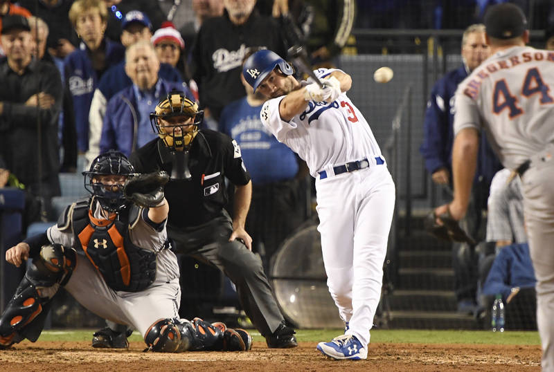 Oct 31, 2017; Los Angeles, CA, USA; Los Angeles Dodgers second baseman Charlie Culberson (37) hits a single against the Houston Astros in the eighth inning in game six of the 2017 World Series at  ...