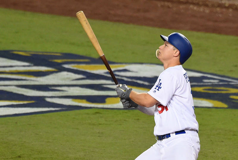 Oct 31, 2017; Los Angeles, CA, USA; Los Angeles Dodgers outfielder Joc Pederson hits a solo home run against the Houston Astros in the 7th inning in game six of the 2017 World Series at Dodger Sta ...