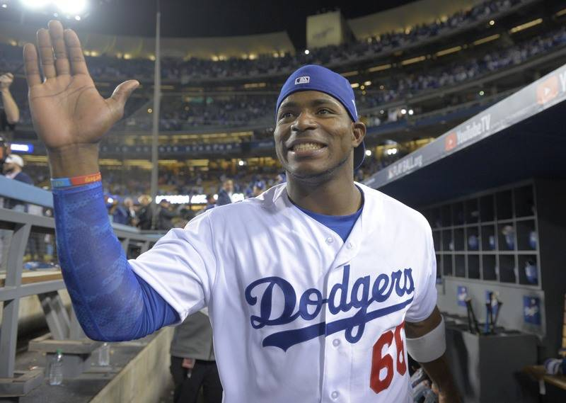 Oct 31, 2017; Los Angeles, CA, USA; Los Angeles Dodgers right fielder Yasiel Puig celebrates after defeating the Houston Astros in game six of the 2017 World Series at Dodger Stadium. Mandatory Cr ...