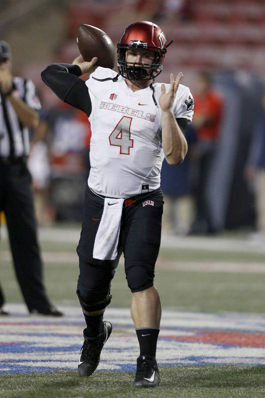 Oct 28, 2017; Fresno, CA, USA; UNLV Rebels quarterback Johnny Stanton (4) warms up before the start of the game against the Fresno State Bulldogs at Bulldog Stadium. Mandatory Credit: Cary Edmonds ...