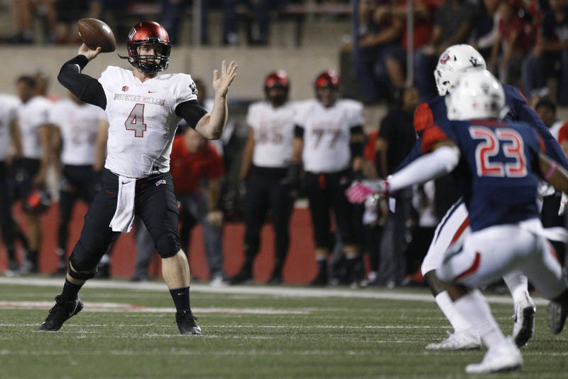Oct 28, 2017; Fresno, CA, USA; UNLV Rebels quarterback Johnny Stanton (4) prepares to throw a pass against the Fresno State Bulldogs in the first quarter at Bulldog Stadium. Mandatory Credit: Cary ...
