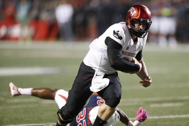 Oct 28, 2017; Fresno, CA, USA; UNLV Rebels quarterback Johnny Stanton (4) runs the ball against the Fresno State Bulldogs in the second quarter at Bulldog Stadium. Mandatory Credit: Cary Edmondson ...