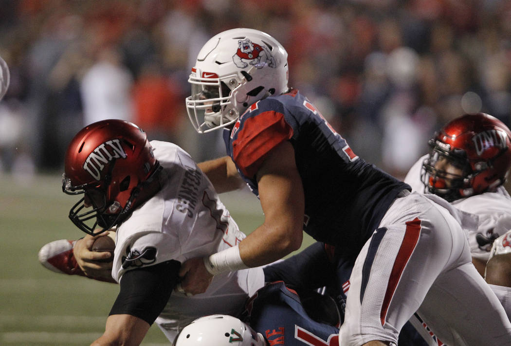 UNLV's quarterback Johnny Stanton is tackled at the goal line by Fresno State's George Helmuth during the first half of an NCAA college football game in Fresno, Calif., Saturday, Oct. 28 2017. (AP ...