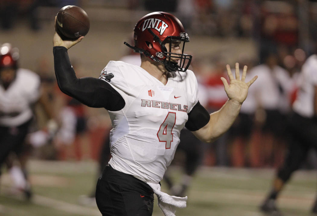 UNLV's Johnny Stanton stands in to throw a pass against Fresno State during the first half of an NCAA college football game in Fresno, Calif., Saturday, Oct. 28 2017. (AP Photo/Gary Kazanjian)