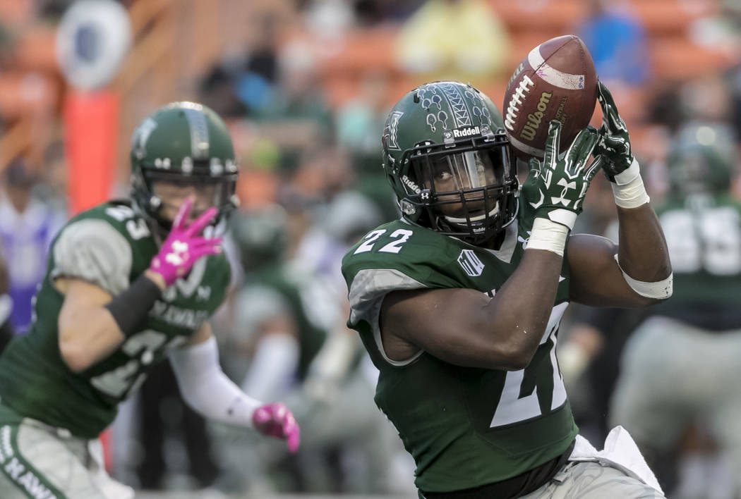 Hawaii running back Diocemy Saint Juste (22) catches a pass in the first quarter of an NCAA college football game against Hawaii, Saturday, Oct. 28, 2017, in Honolulu. (AP Photo/Eugene Tanner)