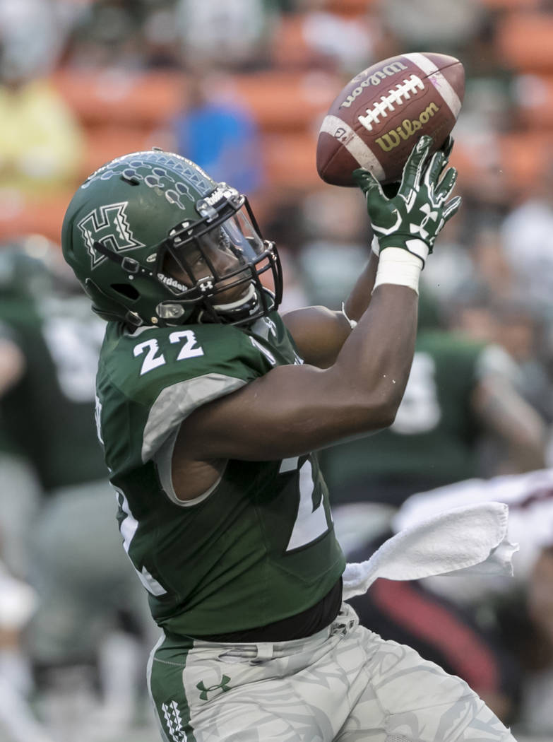 Hawaii running back Diocemy Saint Juste (22) attempts to catch a pass in the first quarter of an NCAA college football game, Saturday, Oct. 28, 2017, in Honolulu. (AP Photo/Eugene Tanner)