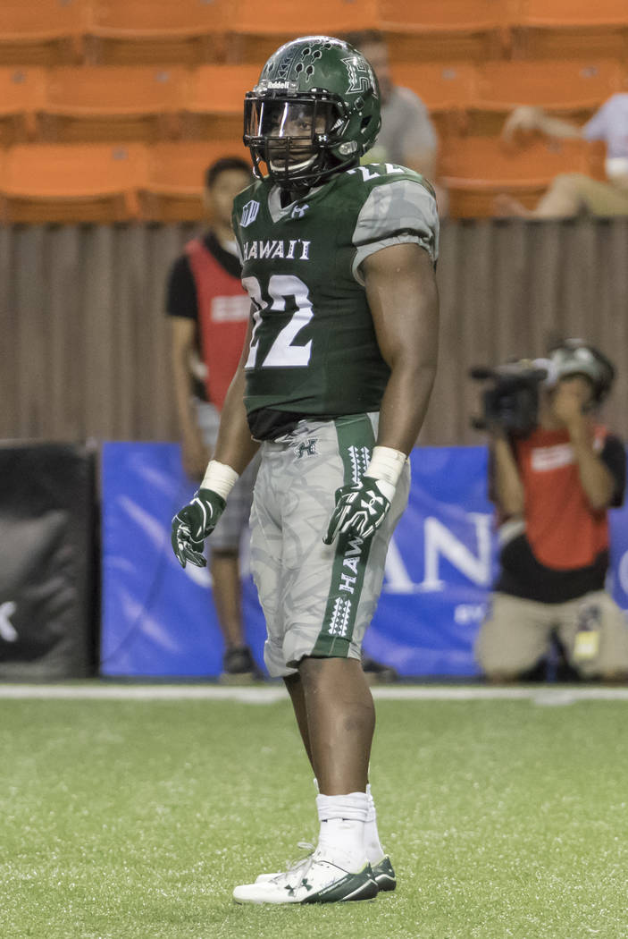 Hawaii running back Diocemy Saint Juste (22) looks over to the sideline in the third quarter of an NCAA college football game, Saturday, Oct. 28, 2017, in Honolulu. (AP Photo/Eugene Tanner)