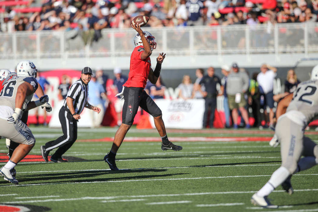UNLV Rebels quarterback Armani Rogers (1) throws a pass against the Utah State Aggies during the second quarter of a football game at Sam Boyd Stadium in Las Vegas, Saturday, Oct. 21, 2017. Joel A ...