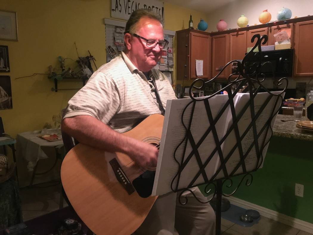 """Boundless Brothers band member David Mathis Sr. playing guitar during rehearsal for the show """"Broke Old Goat, Hawt Young Chick,"""" on Oct. 31, 2017 at Marco's home. (Kailyn Brown/View) @KailynHype"""