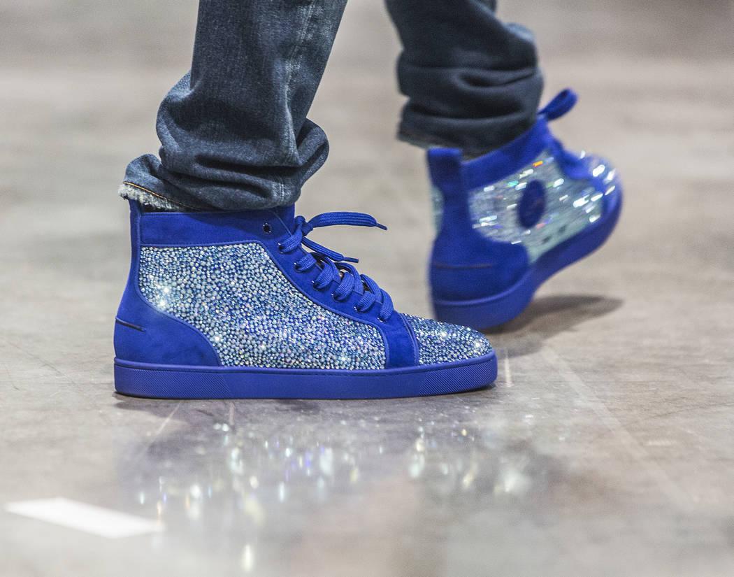 "Cordero Brady, aka ""CJ so Cool"" sports his custom kicks during Sneaker Con at the Las Vegas Convention Center on Saturday, Nov. 11, 2017, in Las Vegas.  Benjamin Hager Las Vegas  ..."
