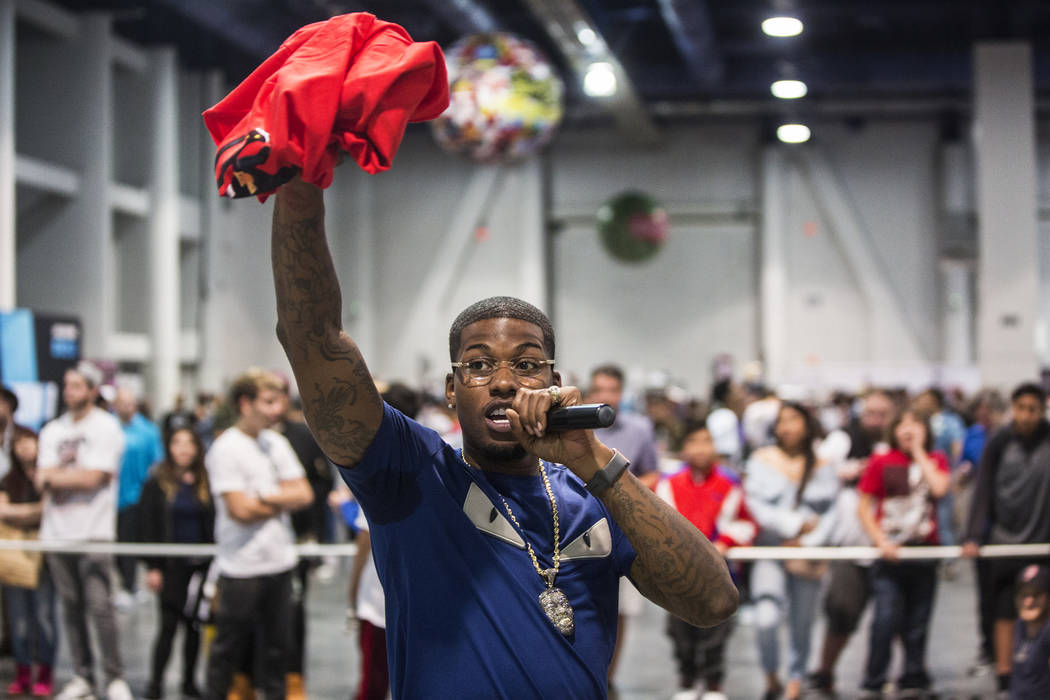 "Cordero Brady, aka ""CJ so Cool"" hands out free tee shirts during Sneaker Con at the Las Vegas Convention Center on Saturday, Nov. 11, 2017, in Las Vegas.  Benjamin Hager Las Vega ..."