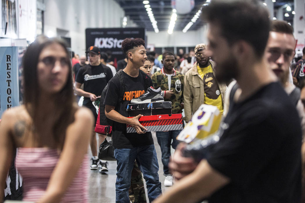 Shoppers load up on custom kicks during Sneaker Con at the Las Vegas Convention Center on Saturday, Nov. 11, 2017, in Las Vegas.  Benjamin Hager Las Vegas Review-Journal @benjaminhphoto