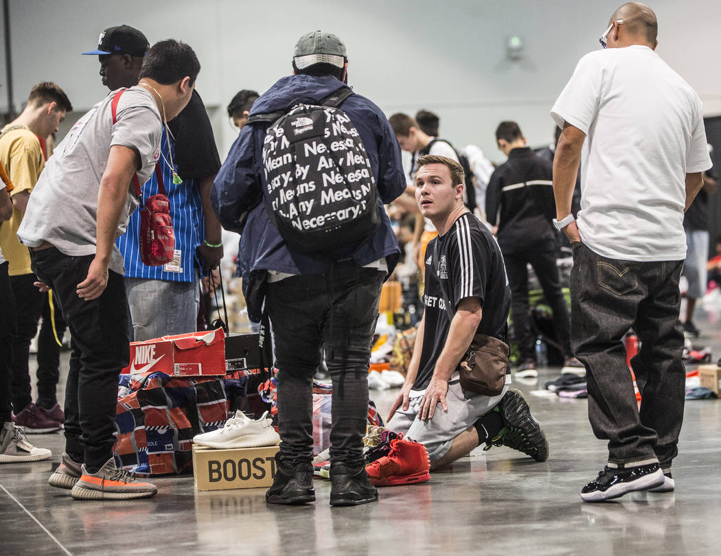 Groups of kids make small shoe transactions in the back area of Sneaker Con at the Las Vegas Convention Center on Saturday, Nov. 11, 2017, in Las Vegas.  Benjamin Hager Las Vegas Review-Journal @b ...