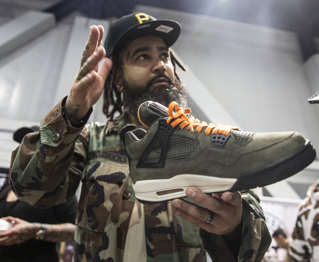 Jaysee Lopez holds a pair of Undefeated Jordans valued at seventeen thousand dollars during Sneaker Con at the Las Vegas Convention Center on Saturday, Nov. 11, 2017, in Las Vegas.  Benjamin Hager ...
