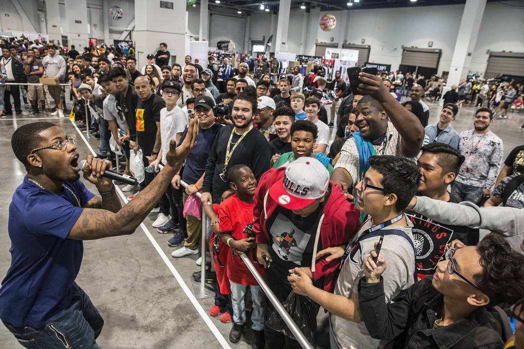 "Cordero Brady, left, aka ""CJ so Cool"" pumps up the crowd during Sneaker Con at the Las Vegas Convention Center on Saturday, Nov. 11, 2017, in Las Vegas.  Benjamin Hager Las Vegas ..."