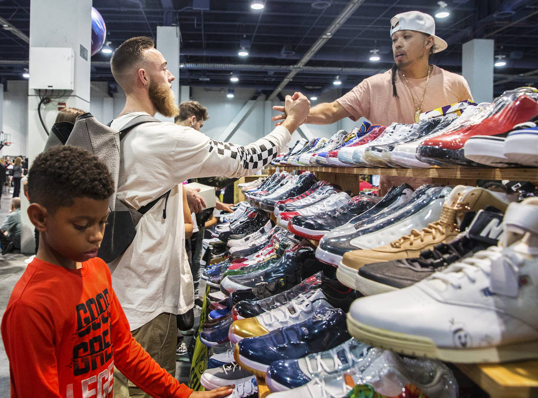 Lane Pollard, left, thanks Peanut Ouch after purchasing a pair of sneakers at Texas Shoe Exchange during Sneaker Con at the Las Vegas Convention Center on Saturday, Nov. 11, 2017, in Las Vegas.  B ...