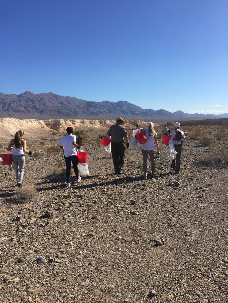Girl Scout members Mirrorajah Metcalfe, Tahoe Mack and Dani Mason participate in cleanup event at Tule Springs Fossil Beds National. (Courtesy of Dawn Mack)