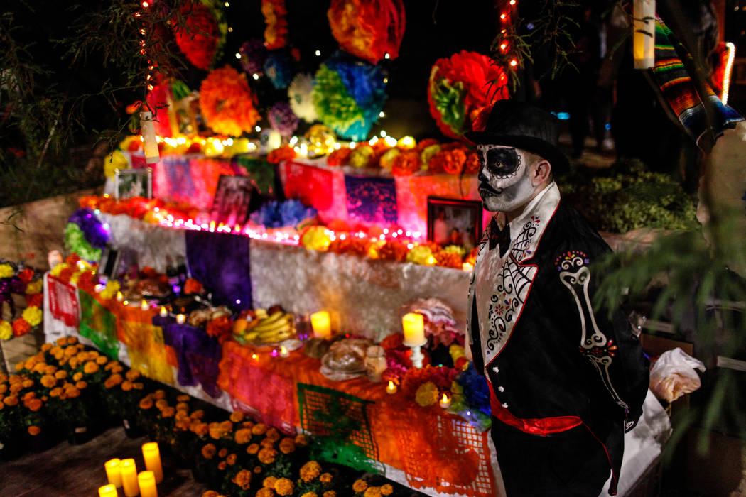 Francisco Soto, 30, of Las Vegas, stands next to an altar during a Dia de los Muertos event at Springs Preserve in Las Vegas, Sunday, Nov. 5, 2017. Joel Angel Juarez Las Vegas Review-Journal @jaju ...