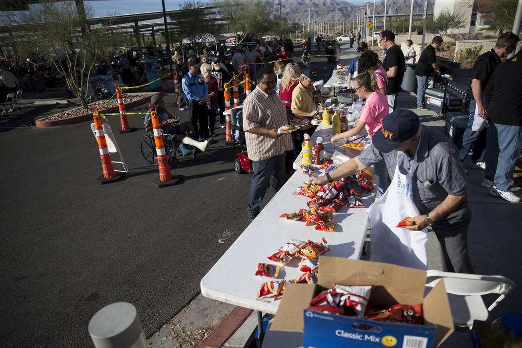 People lineup to get food during the 3rd Annual Car Show and BBQ in celebration of Veterans Day at the VA Southern Nevada Healthcare System in North Las Vegas, Friday, Nov. 10, 2017. Erik Verduzco ...