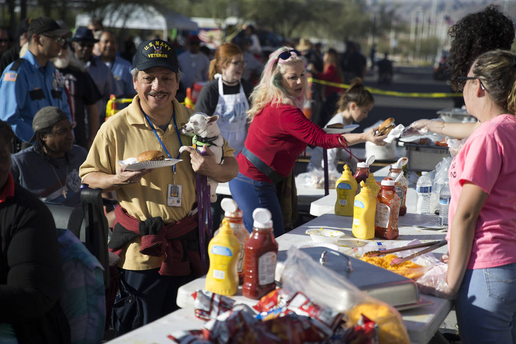 Navy Veteran Fernando Gonzales gets food during the 3rd Annual Car Show and BBQ in celebration of Veterans Day at the VA Southern Nevada Healthcare System in North Las Vegas, Friday, Nov. 10, 2017 ...