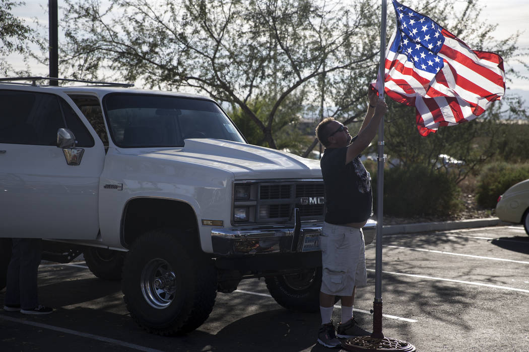 Kevin Ellis lowers his flag at the 3rd Annual Car Show and BBQ in celebration of Veterans Day at the VA Southern Nevada Healthcare System in North Las Vegas, Friday, Nov. 10, 2017. Erik Verduzco L ...