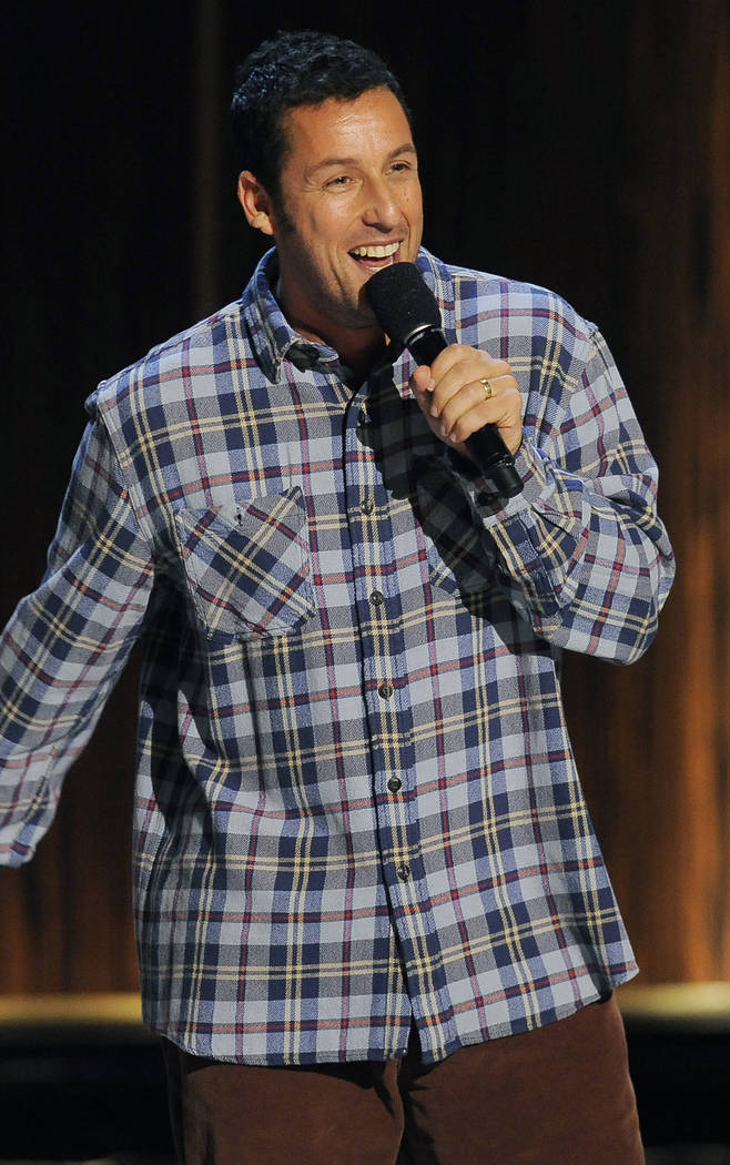 "Comedian Adam Sandler performs at ""Eddie Murphy: One Night Only,"" a celebration of Murphy's career at the Saban Theater on Saturday, Nov. 3, 2012, in Beverly Hills, Calif. (Photo ..."