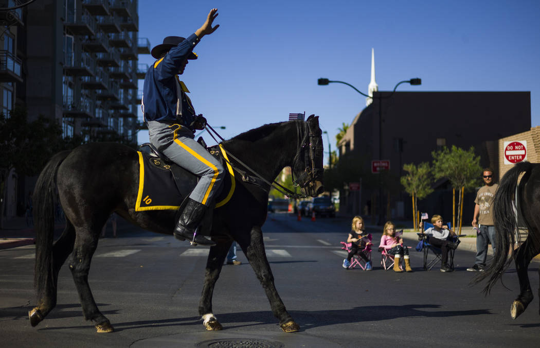 Navy veteran Kelly Hawthorne honors the Buffalo Soldiers during the Veterans Day Parade in downtown Las Vegas on Saturday, Nov. 11, 2017. Chase Stevens Las Vegas Review-Journal @csstevensphoto