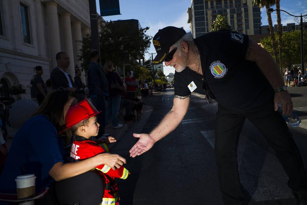 Vietnam veteran Sterling Taylor greets Cruz Preciado, 2, during the Veterans Day Parade in downtown Las Vegas on Saturday, Nov. 11, 2017. Chase Stevens Las Vegas Review-Journal @csstevensphoto