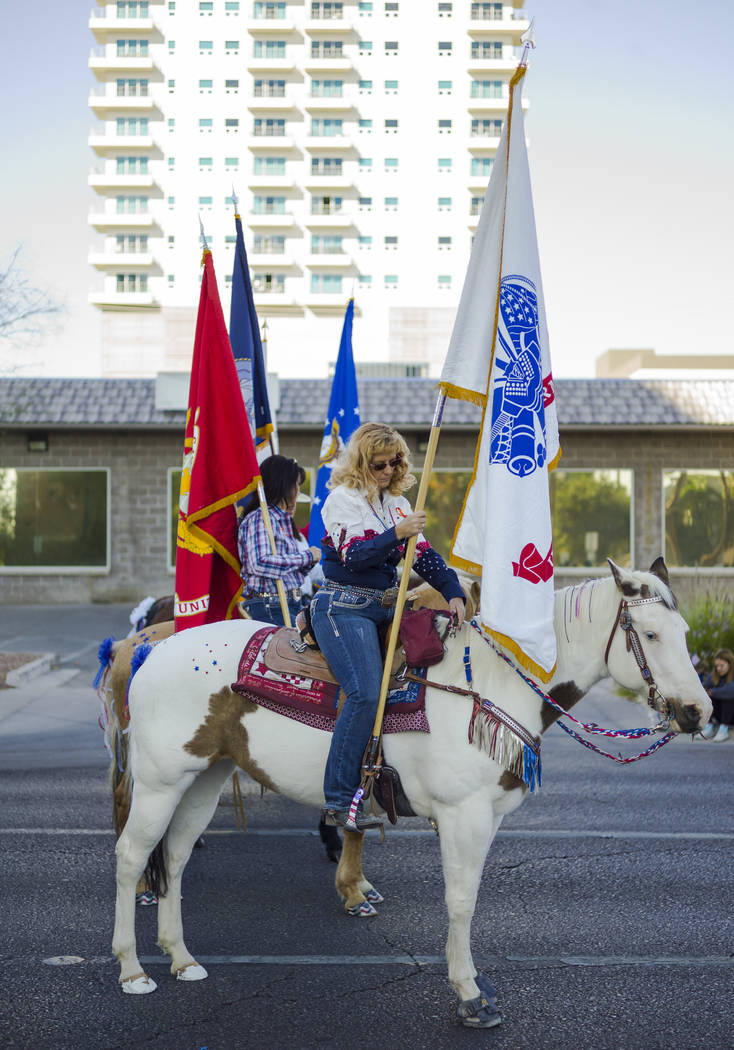 A parade participant readies her horse before the start during the Veterans Day Parade in downtown Las Vegas on Saturday, Nov. 11, 2017. Chase Stevens Las Vegas Review-Journal @csstevensphoto