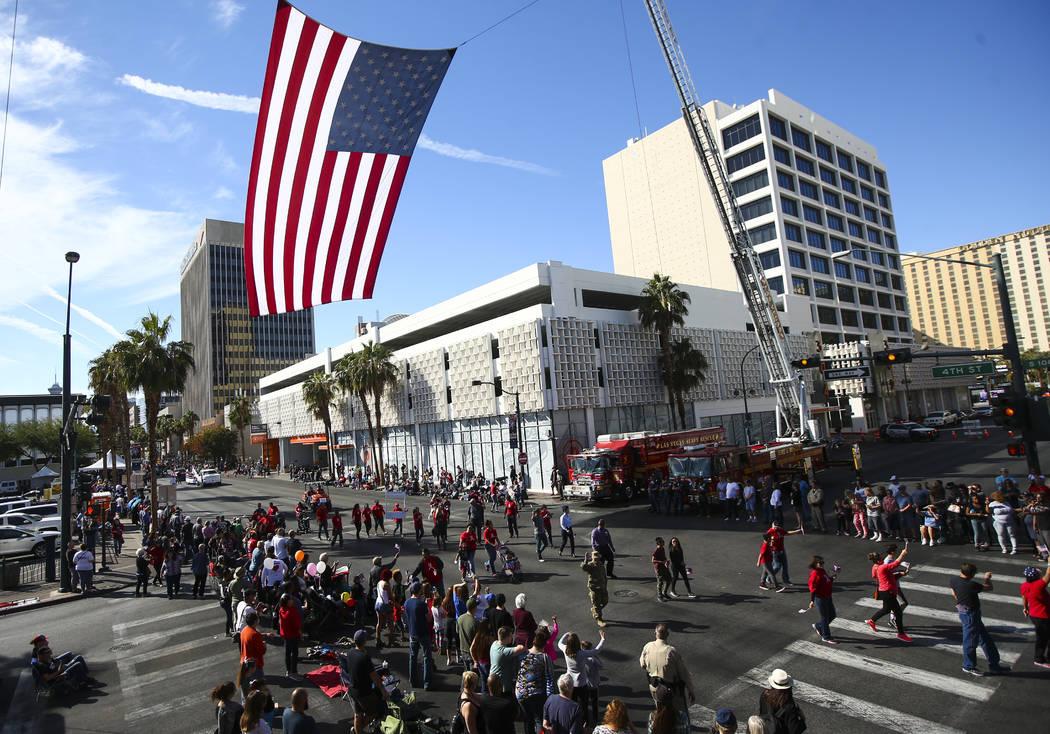 The American flag flies overhead during the Veterans Day Parade in downtown Las Vegas on Saturday, Nov. 11, 2017. Chase Stevens Las Vegas Review-Journal @csstevensphoto