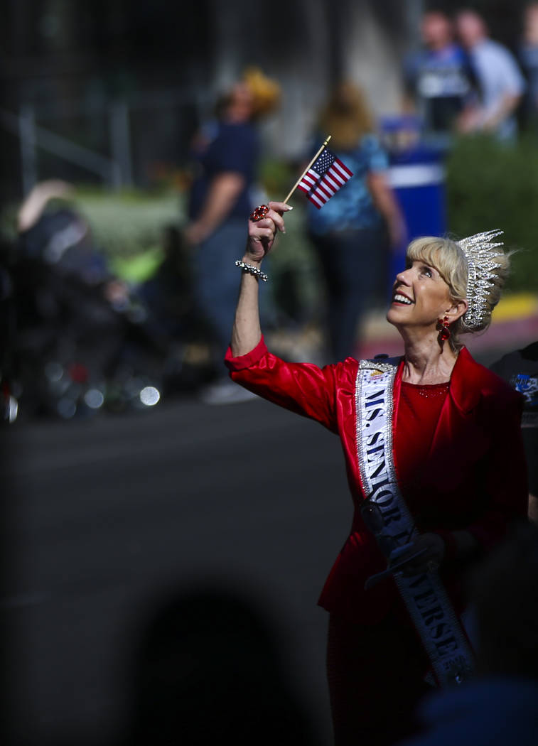 Kathleen Ray watches a helicopter fly overhead during the Veterans Day Parade in downtown Las Vegas on Saturday, Nov. 11, 2017. Chase Stevens Las Vegas Review-Journal @csstevensphoto