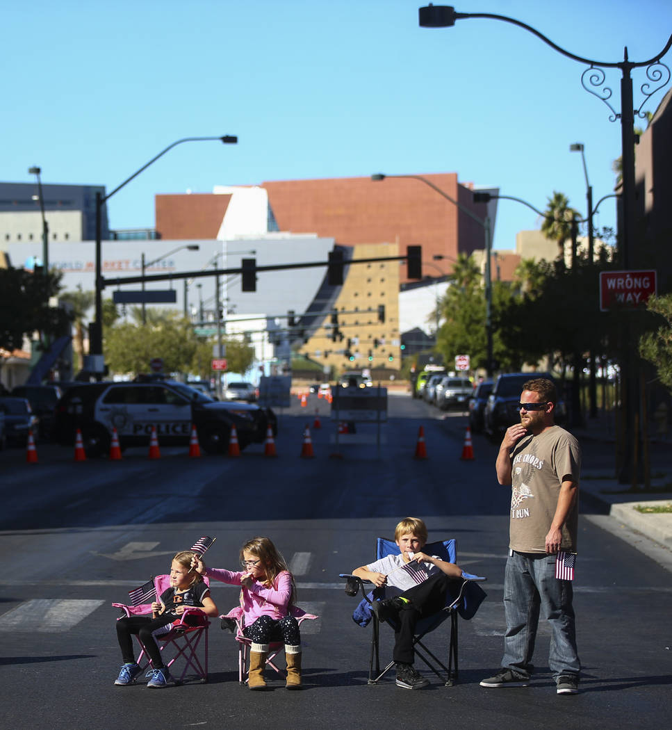 Chris Callahan, right, and his family watch parade participants pass by during the Veterans Day Parade in downtown Las Vegas on Saturday, Nov. 11, 2017. Chase Stevens Las Vegas Review-Journal @css ...