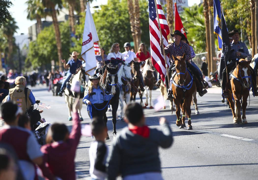 Parade participants on horseback during the Veterans Day Parade in downtown Las Vegas on Saturday, Nov. 11, 2017. Chase Stevens Las Vegas Review-Journal @csstevensphoto