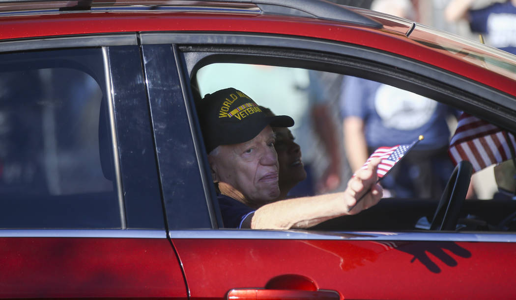 A World War II veteran waves to the crowd during the Veterans Day Parade in downtown Las Vegas on Saturday, Nov. 11, 2017. Chase Stevens Las Vegas Review-Journal @csstevensphoto