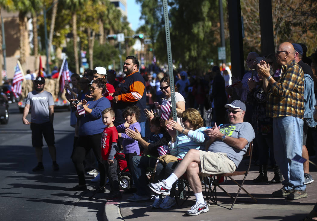 People crowd the streets during the Veterans Day Parade in downtown Las Vegas on Saturday, Nov. 11, 2017. Chase Stevens Las Vegas Review-Journal @csstevensphoto