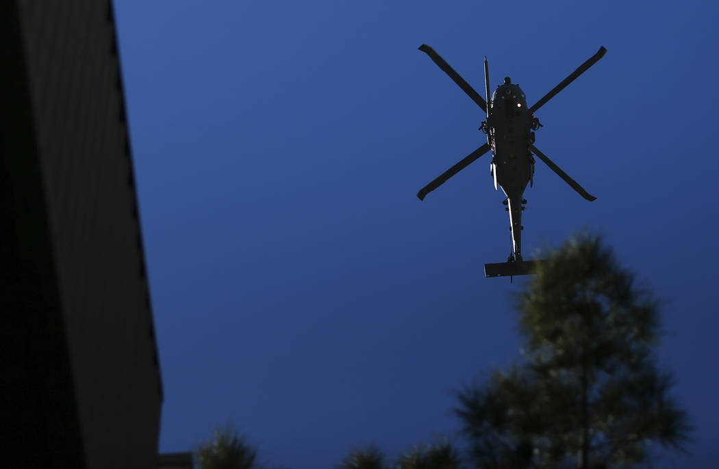 A helicopter passes overhead during the Veterans Day Parade in downtown Las Vegas on Saturday, Nov. 11, 2017. Chase Stevens Las Vegas Review-Journal @csstevensphoto