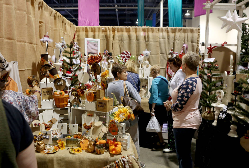 Individuals look around a seasonal themed booth during the final day of the 2017 Craft Festival at the Cashman Center in Las Vegas, Sunday, Nov. 5, 2017. Elizabeth Brumley Las Vegas Review-Journal ...