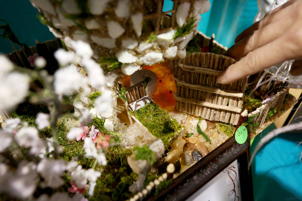 "Nga ""Emmie"" Liapes shows off details of her handmade fairy cottages for purchase during the final day of the 2017 Craft Festival at the Cashman Center in Las Vegas, Sunday, Nov.  ..."