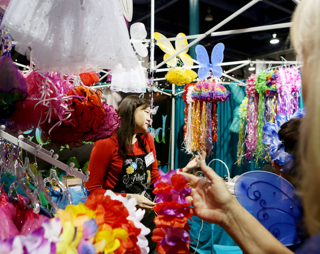 Manager of Wee Fairyland Julie Damon, Las Vegas, helps costumers during the final day of the 2017 Craft Festival at the Cashman Center in Las Vegas, Sunday, Nov. 5, 2017. Elizabeth Brumley Las Veg ...
