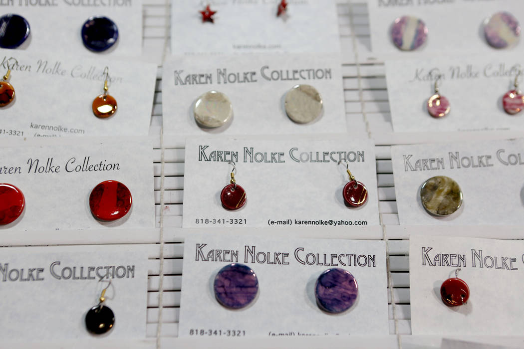 Karen Nolke Collection earrings are for purchase during the final day of the 2017 Craft Festival at the Cashman Center in Las Vegas, Sunday, Nov. 5, 2017. Elizabeth Brumley Las Vegas Review-Journa ...