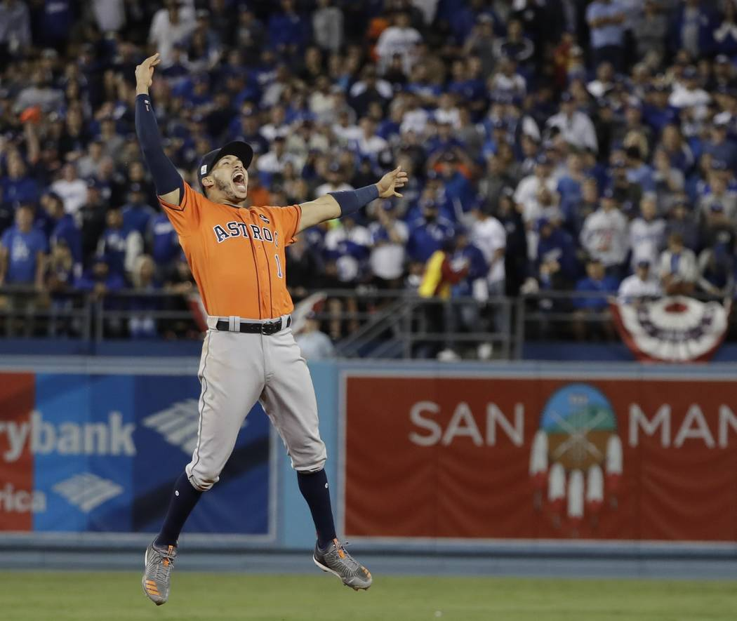 Houston Astros' Carlos Correa celebrates after Game 7 of baseball's World Series against the Los Angeles Dodgers Wednesday, Nov. 1, 2017, in Los Angeles. The Astros won 5-1 to win the series 4-3.  ...
