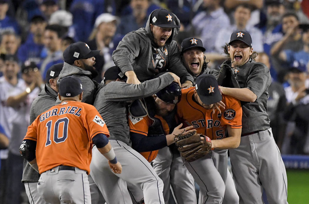 The Houston Astros celebrate after their win against the Los Angeles Dodgers in Game 7 of baseball's World Series Wednesday, Nov. 1, 2017, in Los Angeles. The Astros won 5-1 to win the series 4-3. ...