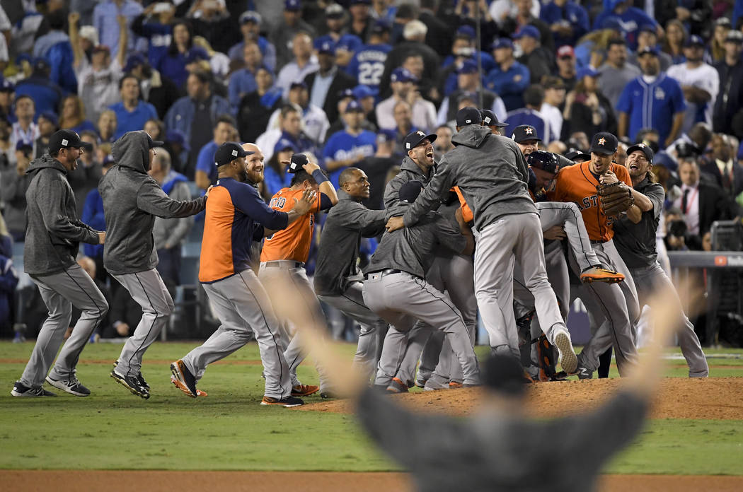 Houston Astros celebrate after their win against the Los Angeles Dodgers in Game 7 of baseball's World Series Wednesday, Nov. 1, 2017, in Los Angeles. The Astros won 5-1 to win the series 4-3. (AP ...
