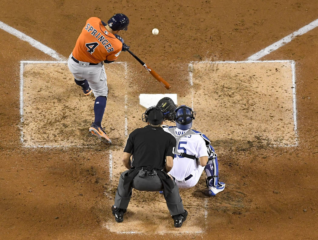 Houston Astros' George Springer, right, hits a two-run home run off Los Angeles Dodgers starting pitcher Yu Darvish, of Japan, during the second inning of Game 7 of baseball's World Series Wednesd ...