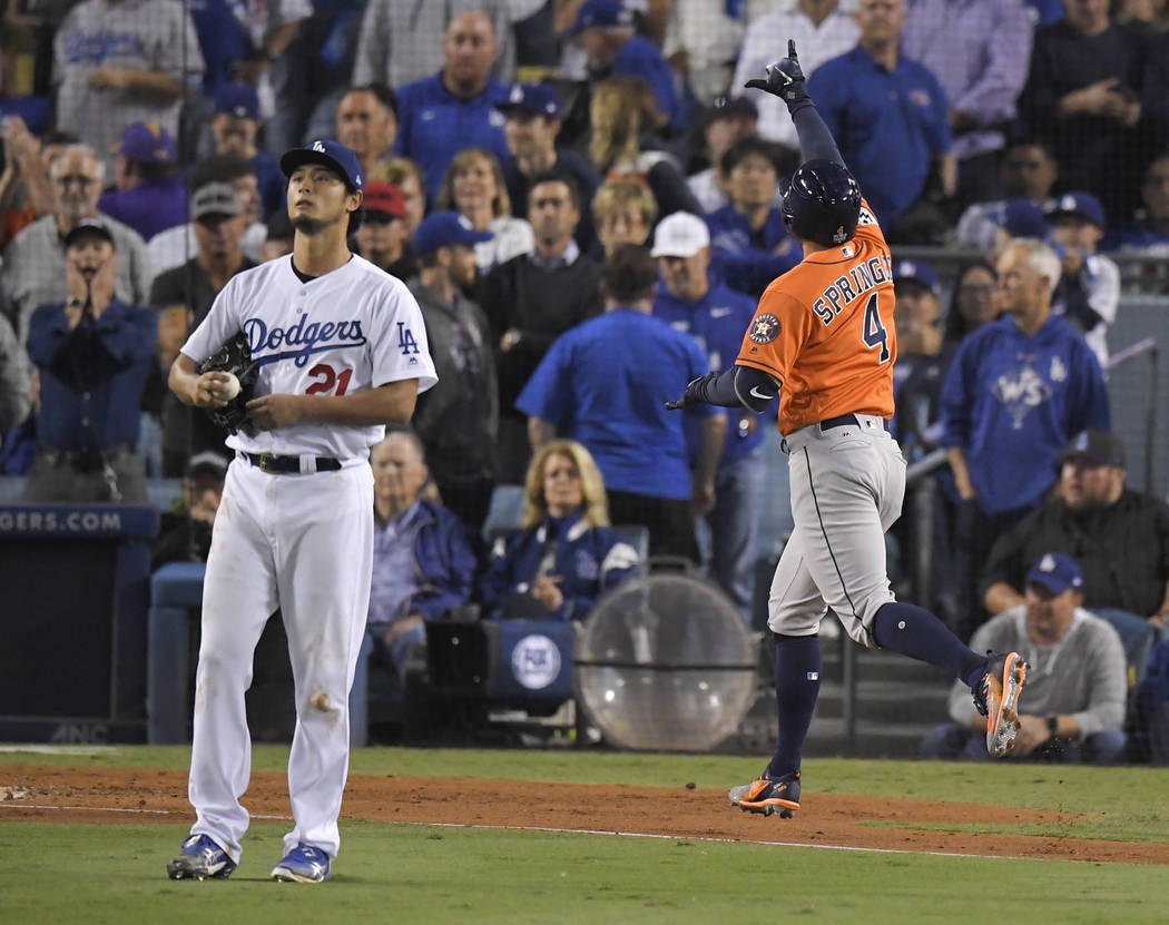 Houston Astros' George Springer, right, celebrates after his two-run home run off Los Angeles Dodgers starting pitcher Yu Darvish, of Japan, during the second inning of Game 7 of baseball's World  ...