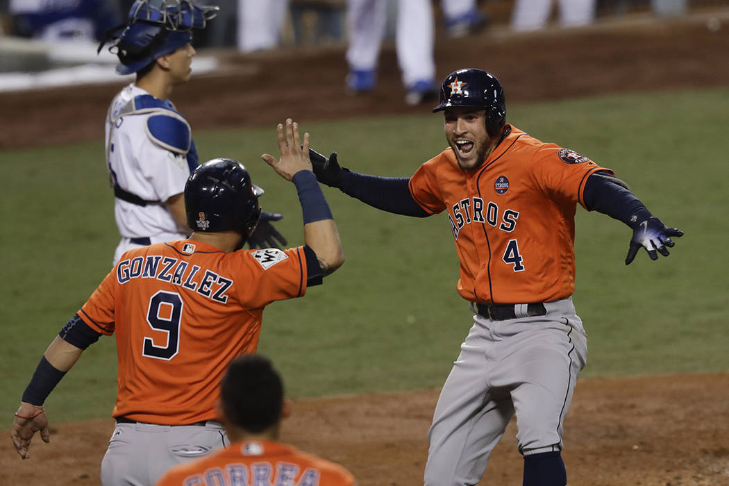 Houston Astros' George Springer (4) celebrates after his two-run home run against the Los Angeles Dodgers during the second inning of Game 7 of baseball's World Series Wednesday, Nov. 1, 2017, in  ...
