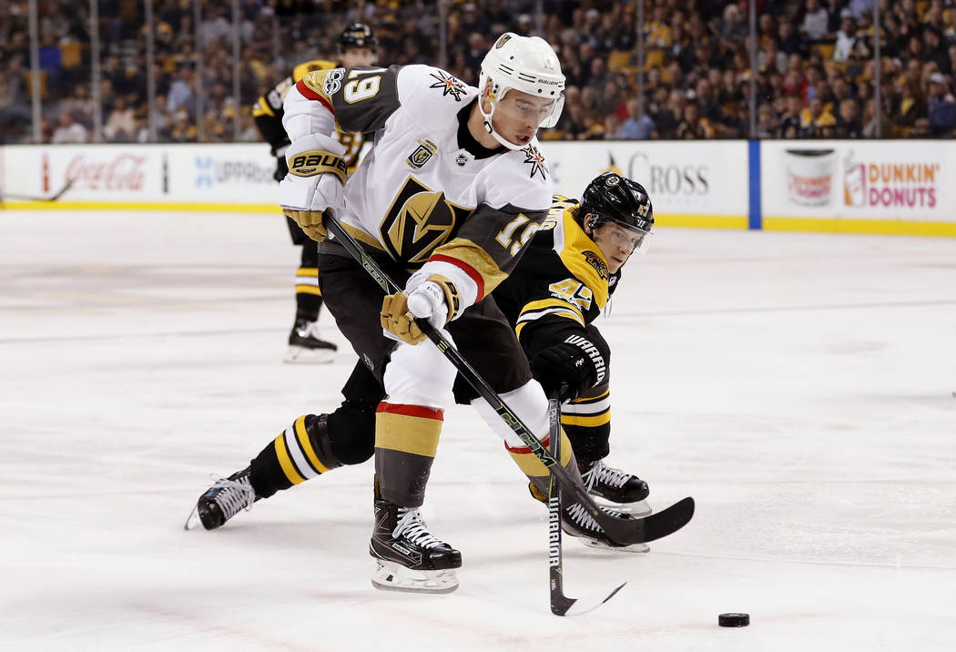 Vegas Golden Knights right wing Reilly Smith (19) tries to get around Boston Bruins defenseman Torey Krug during the first period of an NHL hockey game in Boston, Thursday, Nov. 2, 2017. (AP Photo ...