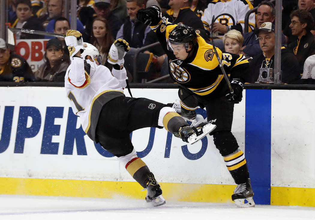 Boston Bruins' Charlie McAvoy, right, collides with Vegas Golden Knights' Cody Eakin during the first period of an NHL hockey game in Boston Thursday, Nov. 2, 2017. (AP Photo/Winslow Townson)